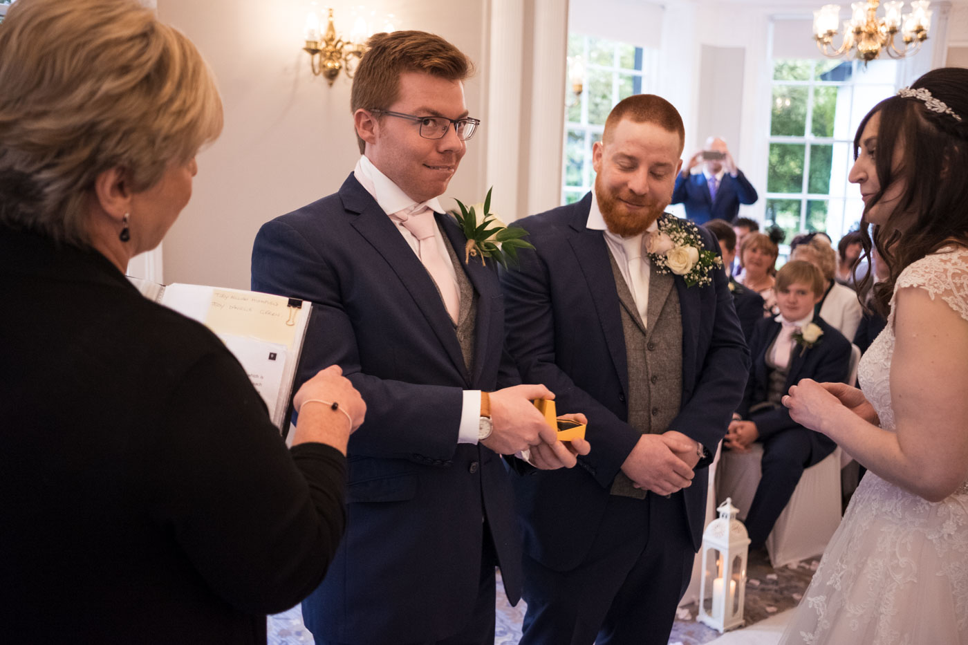 best man handing over the rings