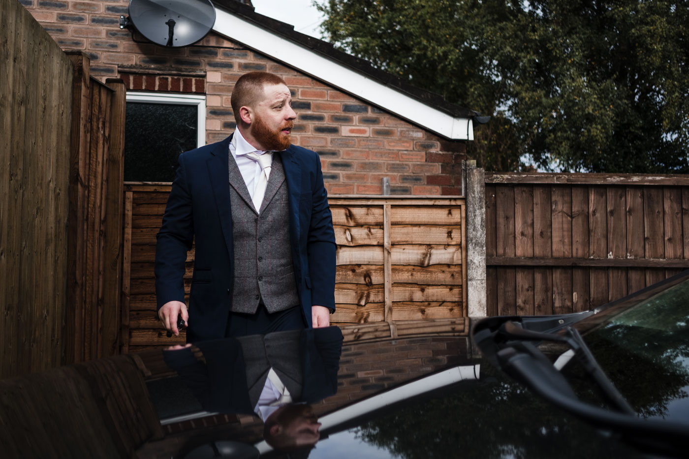 groom with reflection in car