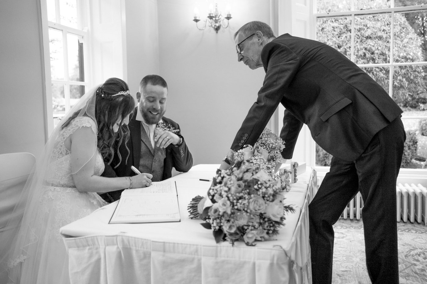 bride and groom signing the marriage register