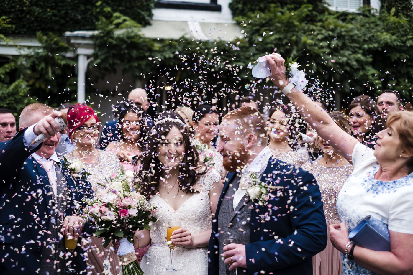 confetti shot of bride and groom