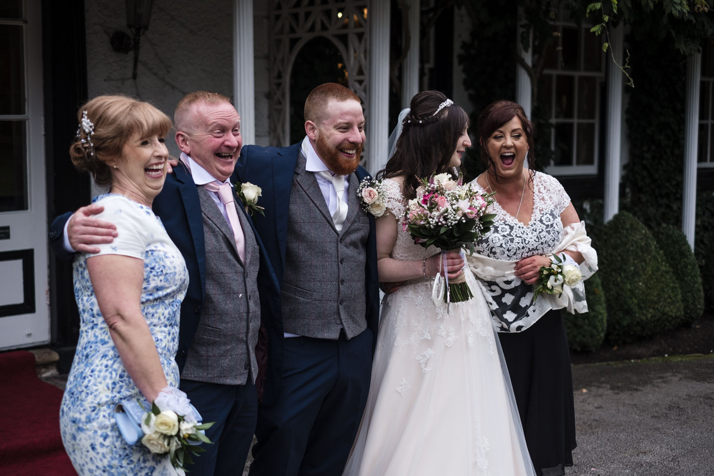 guests laughing during the wedding group shots, north west wedding photography
