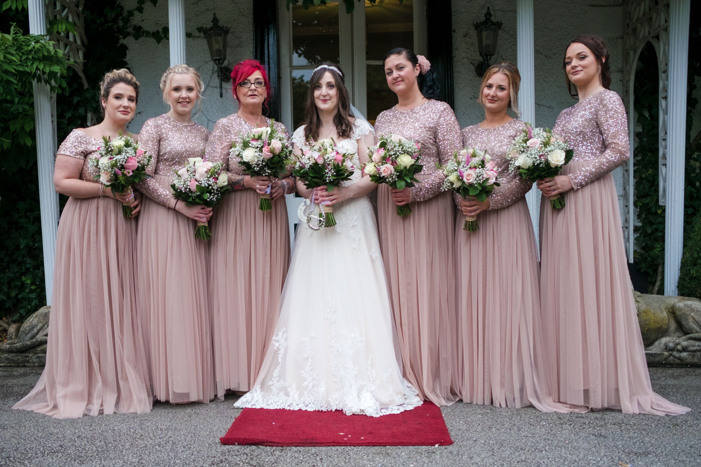 bride and bridemaids in front of the hotel, delicate pink bridesmaid dresses