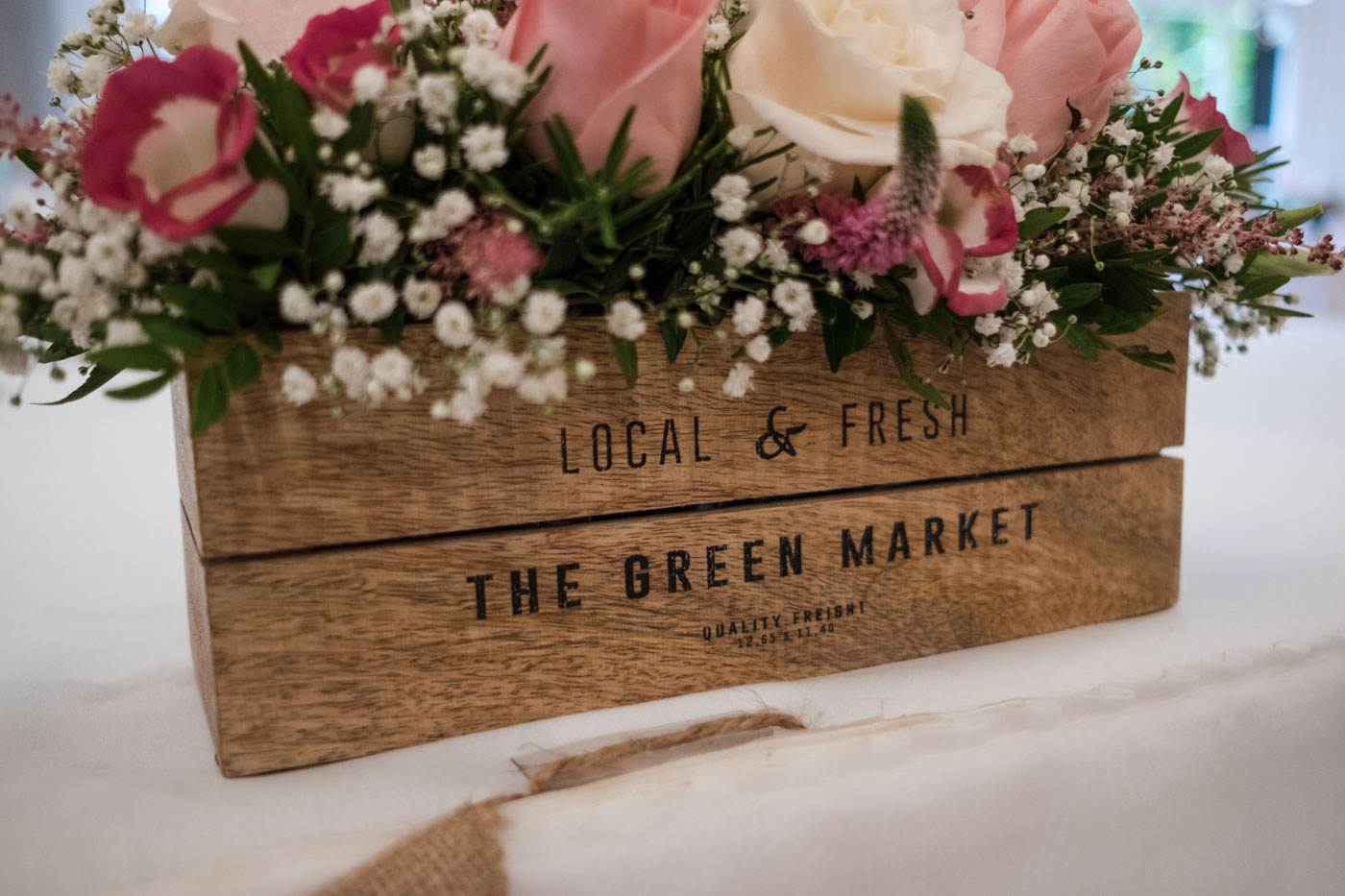 top table flower decoration with rustic crate and pink flowers