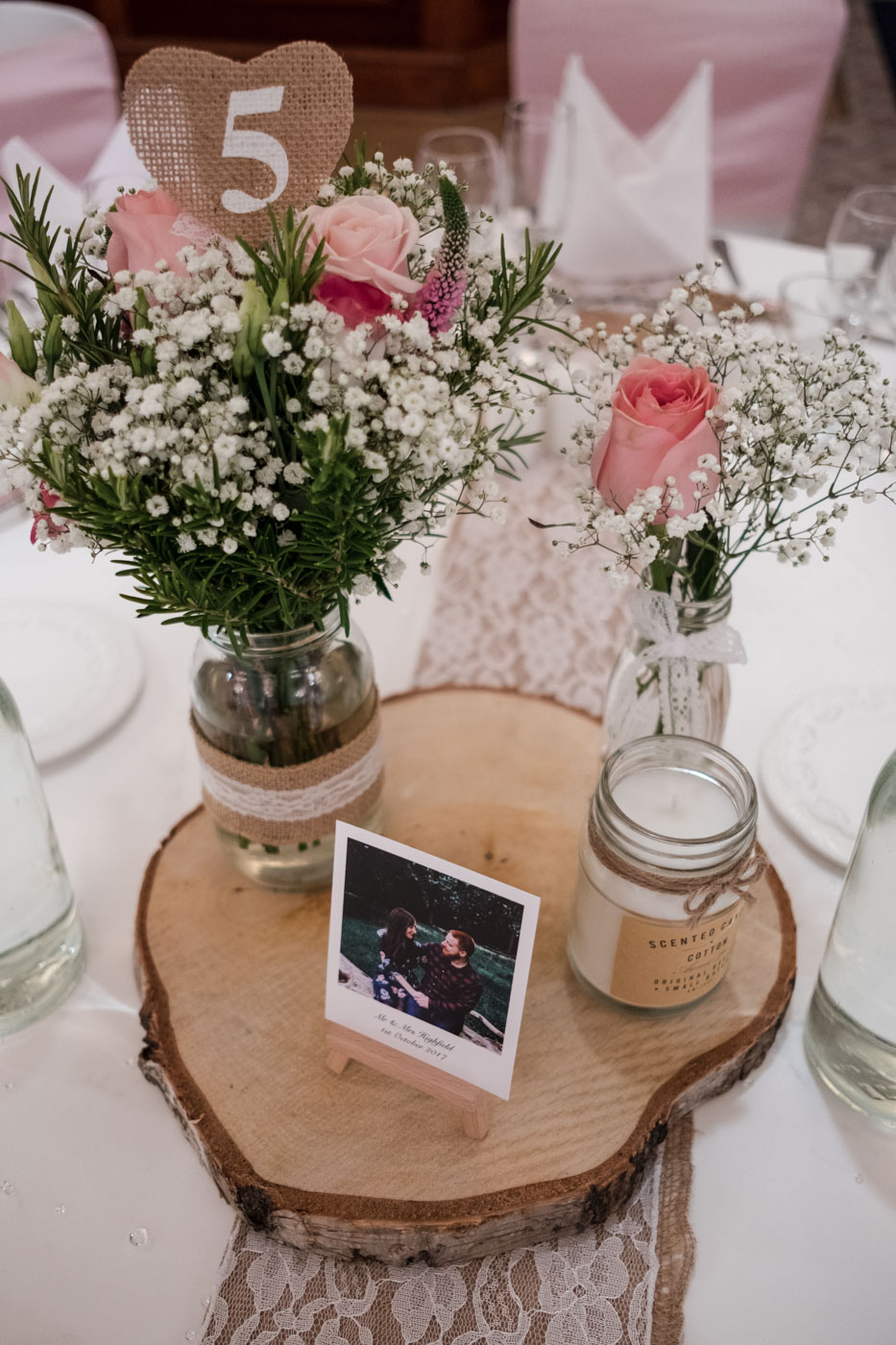 rustic table decorations with log slice and candles