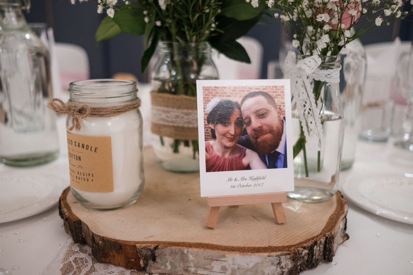 hand made polaroid style table decoration with mini easel