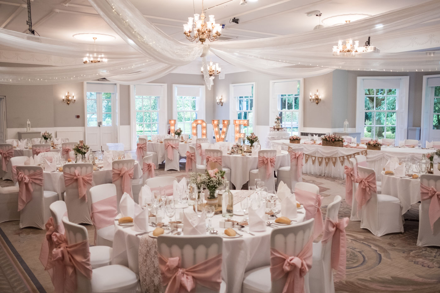 room details at statham lodge, rustic wedding decor with a touch of pink