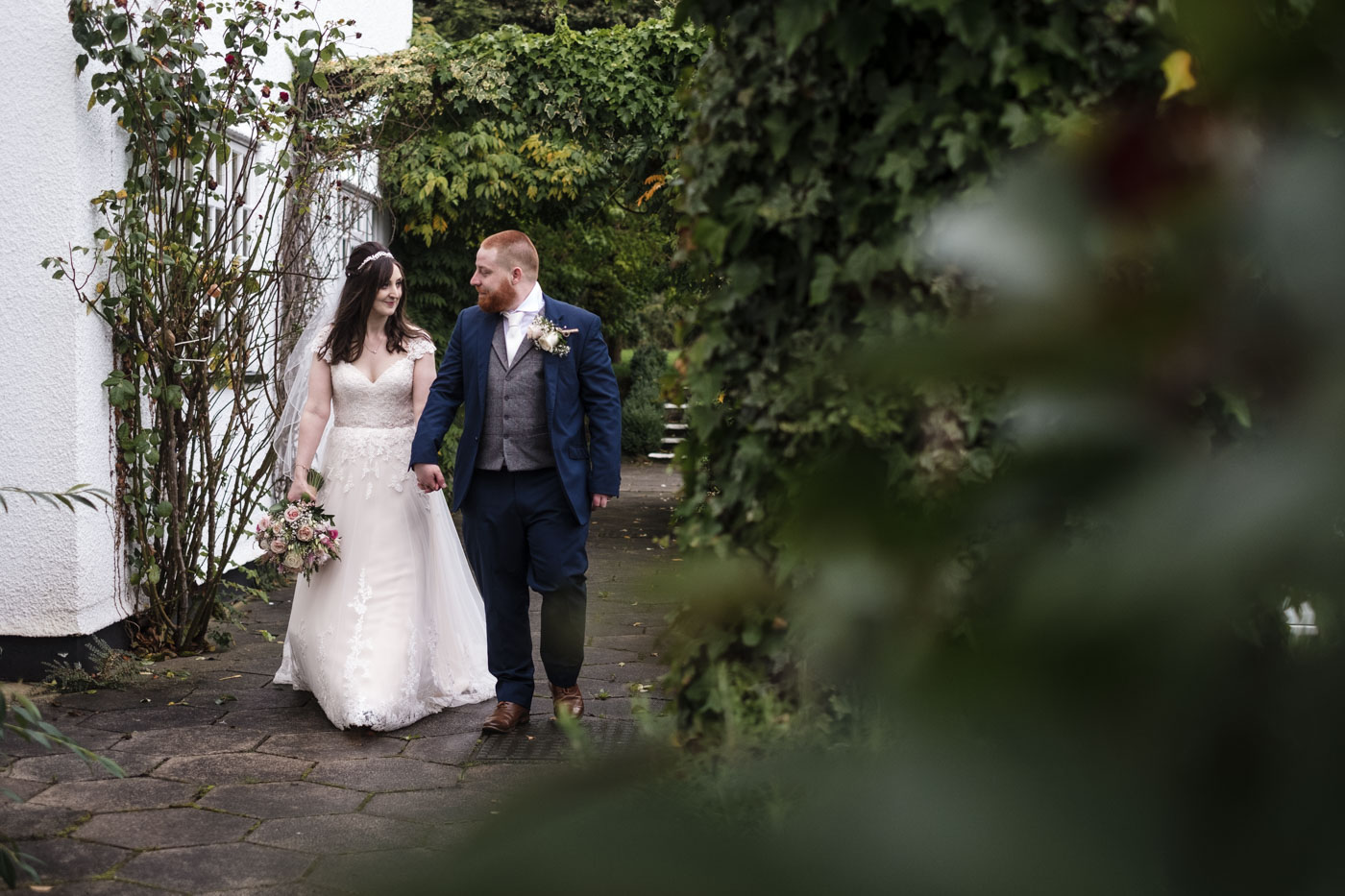 unposed couple portraits in the gardens of country house venue