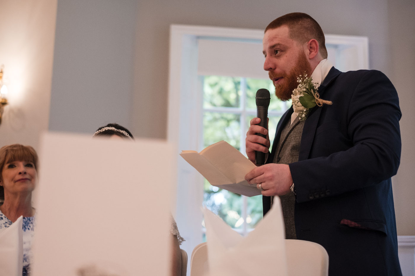 groom with microphone giving speech, wedding speech at statham lodge