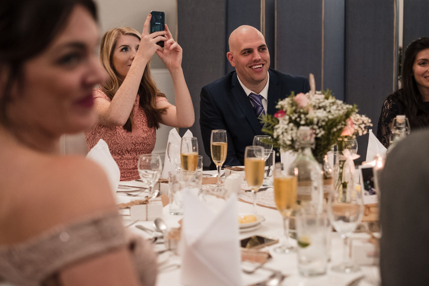 wedding guests laughing and smiling