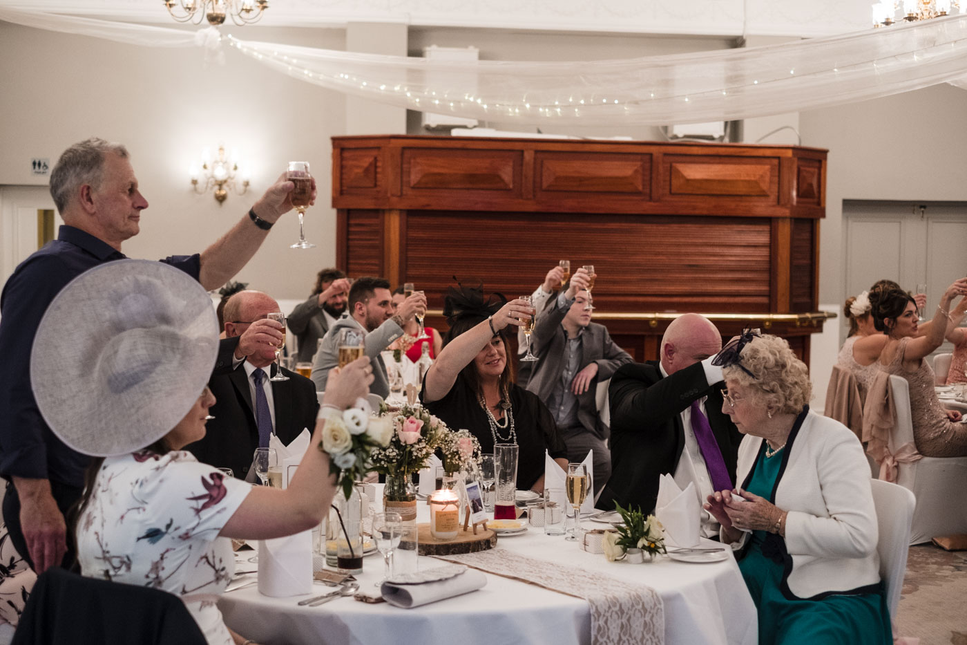 guests toasting to the wedding speeches