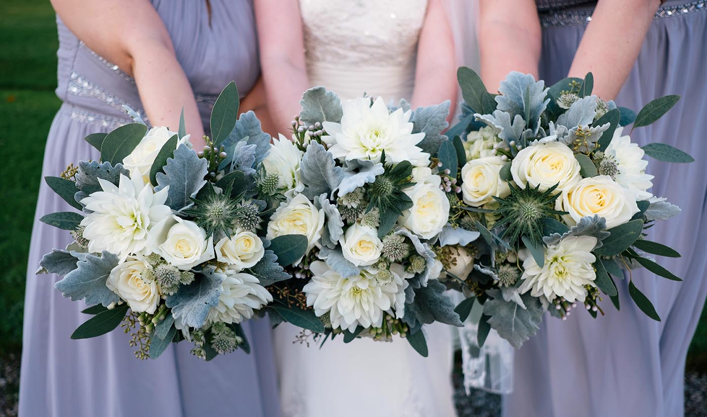 bridesmaids holding bouquets at Eaves Hall wedding