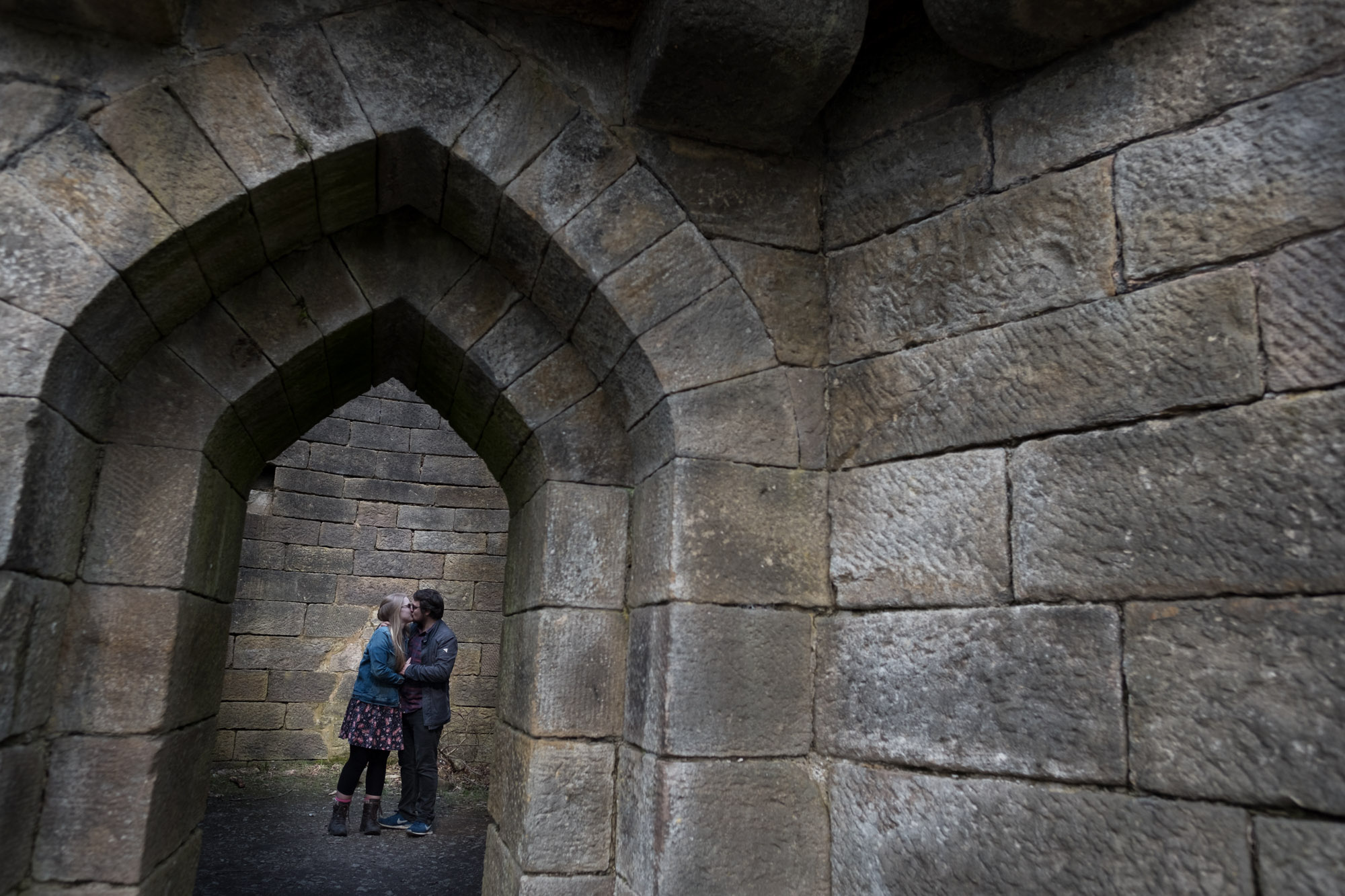 couple kissing through archway door at Liverpool Castle