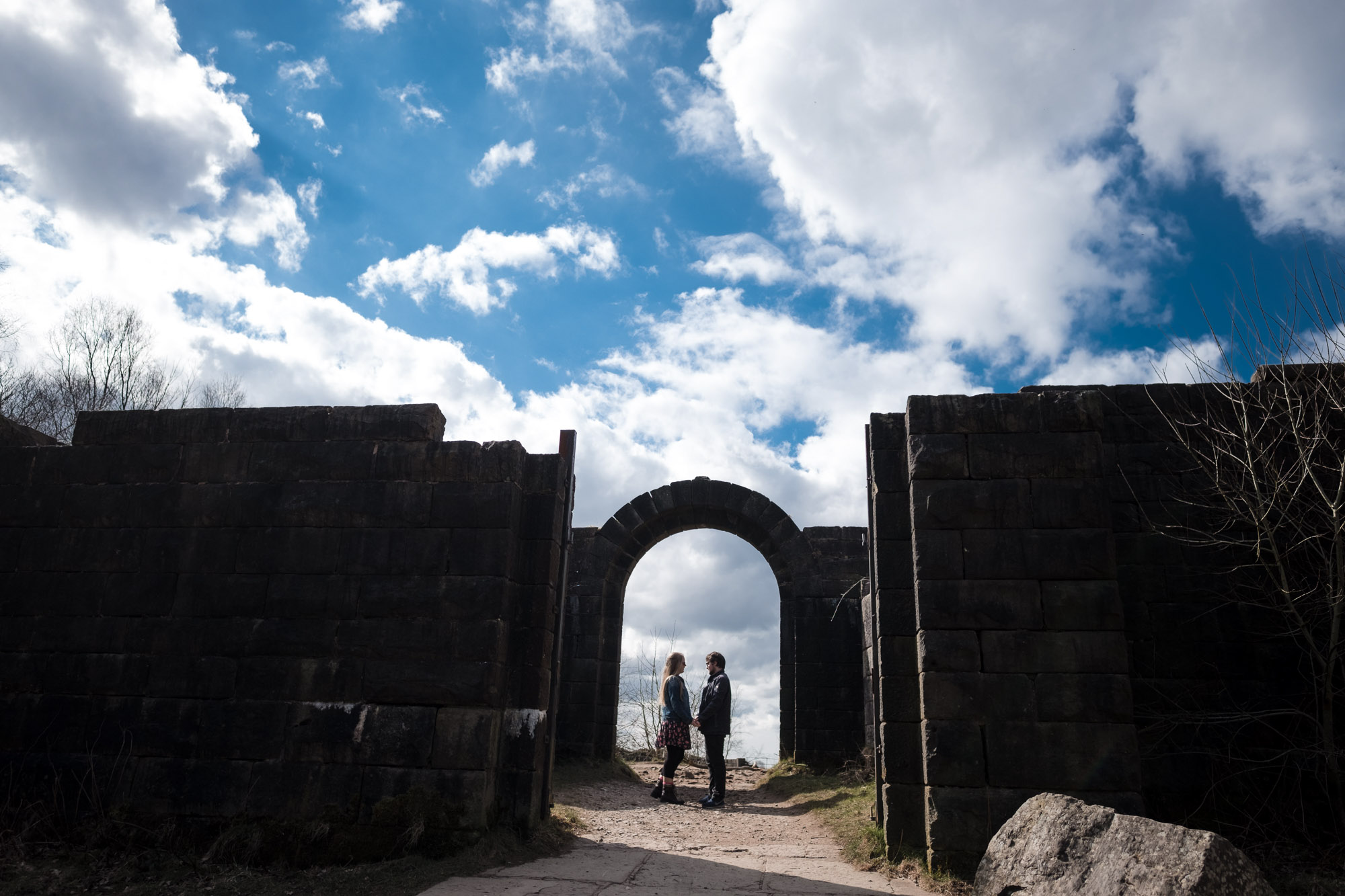 Amy and Gary standing under archway at Liverpool Castle in Rivington