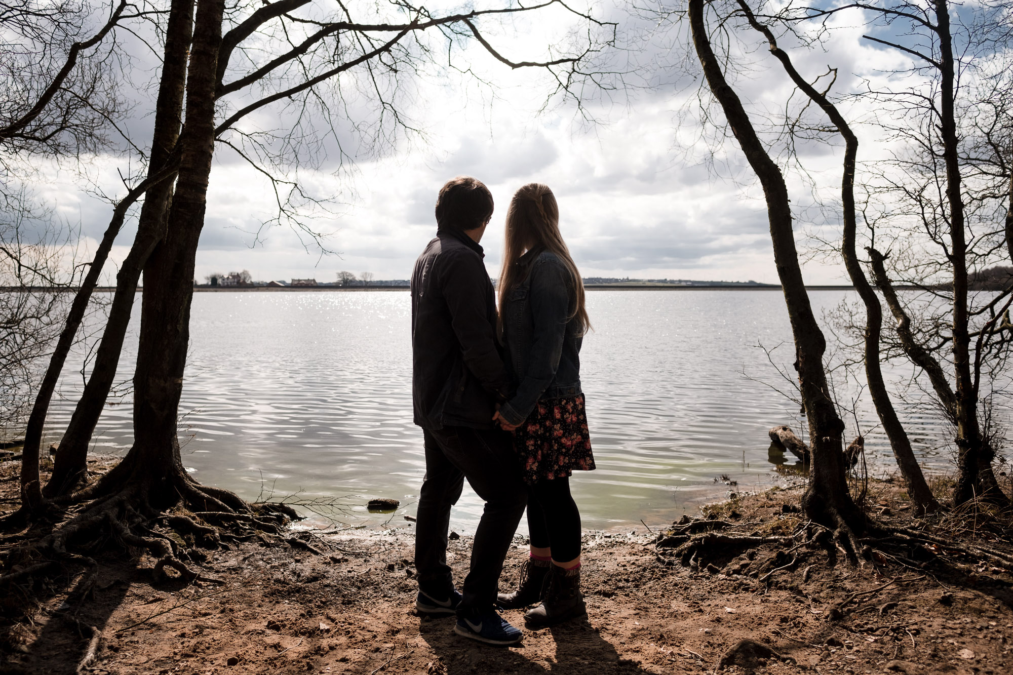 couple overlooking rivington reservoir on sunny day