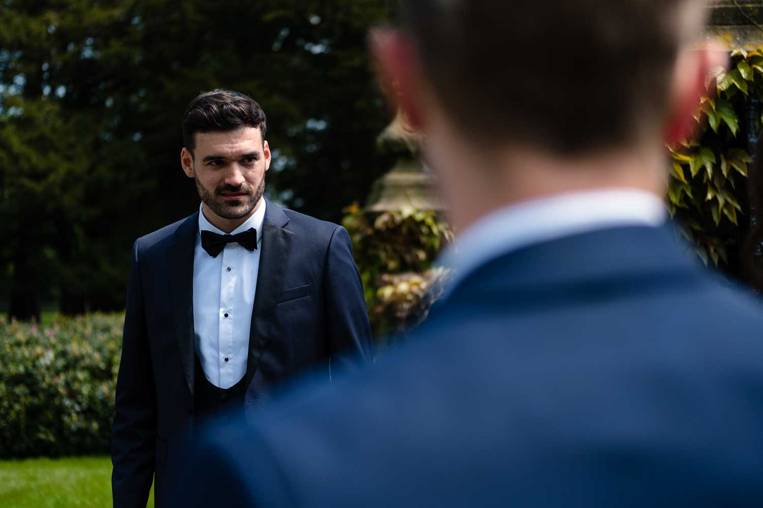 groom talking to guest