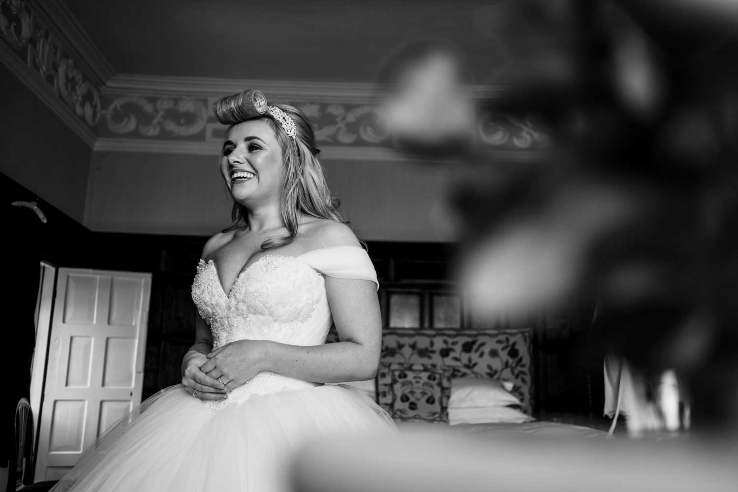 bride laughing as she waits