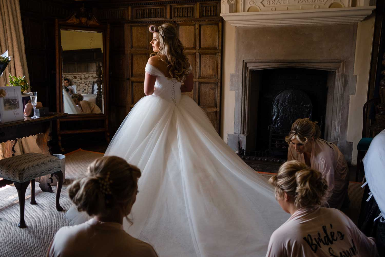 bridesmaids looking at brides dress for first time