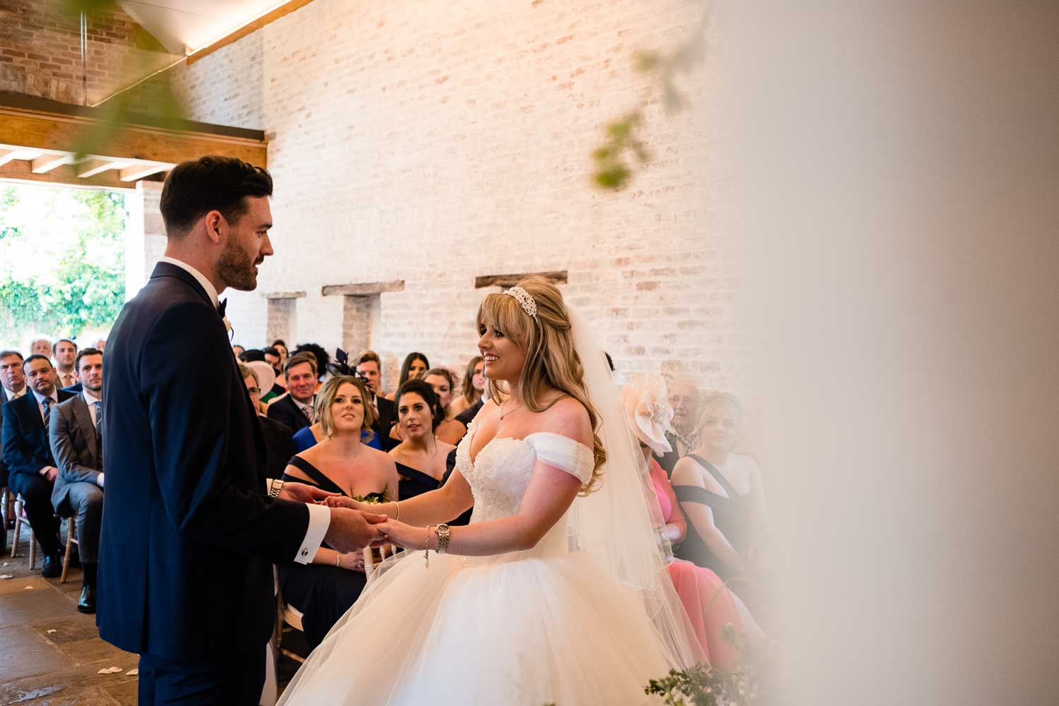 couple looking at each other during wedding ceremony with celebrant