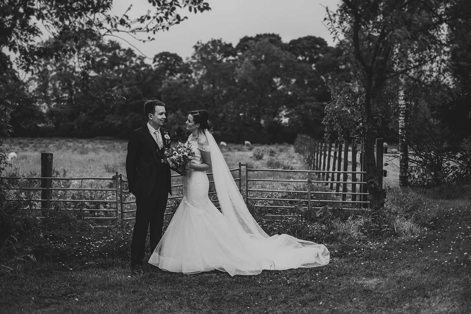 bride and groom portraits in the gardens at The Out Barn