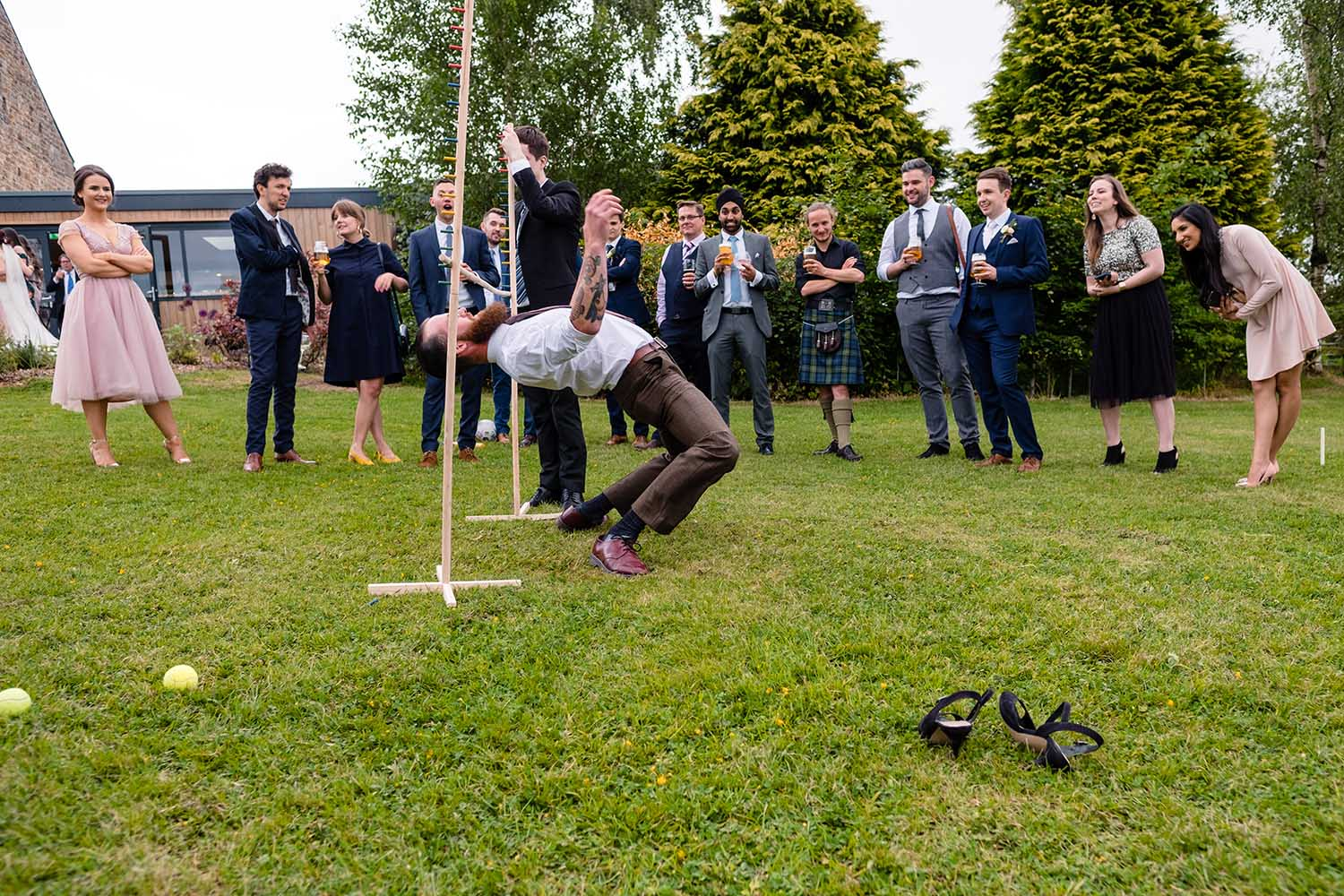wedding guests playing garden games at the outbarn