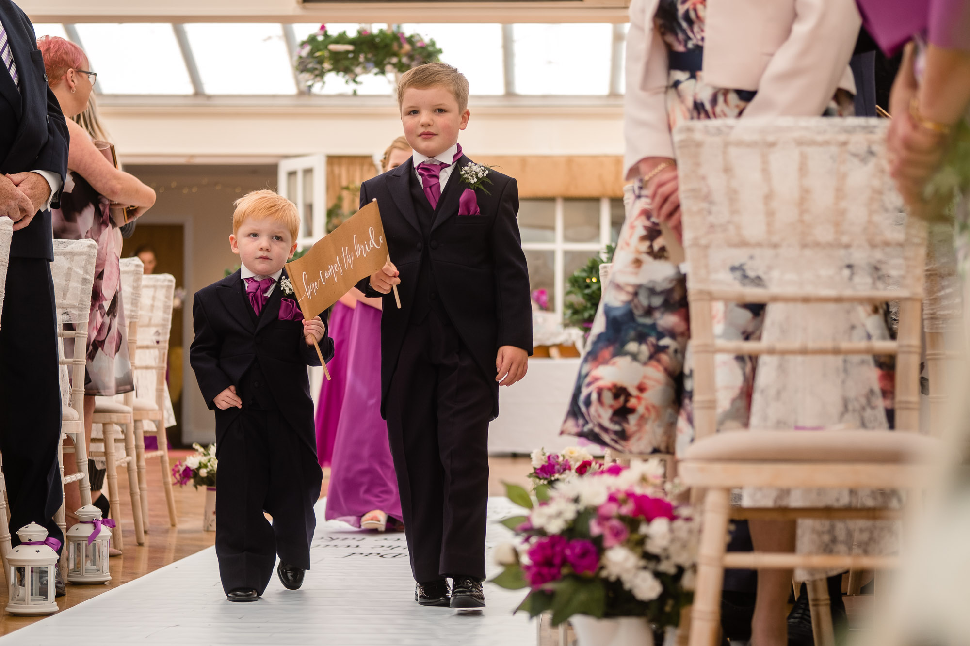 paige boys walking down the aisle at the mere court hotel