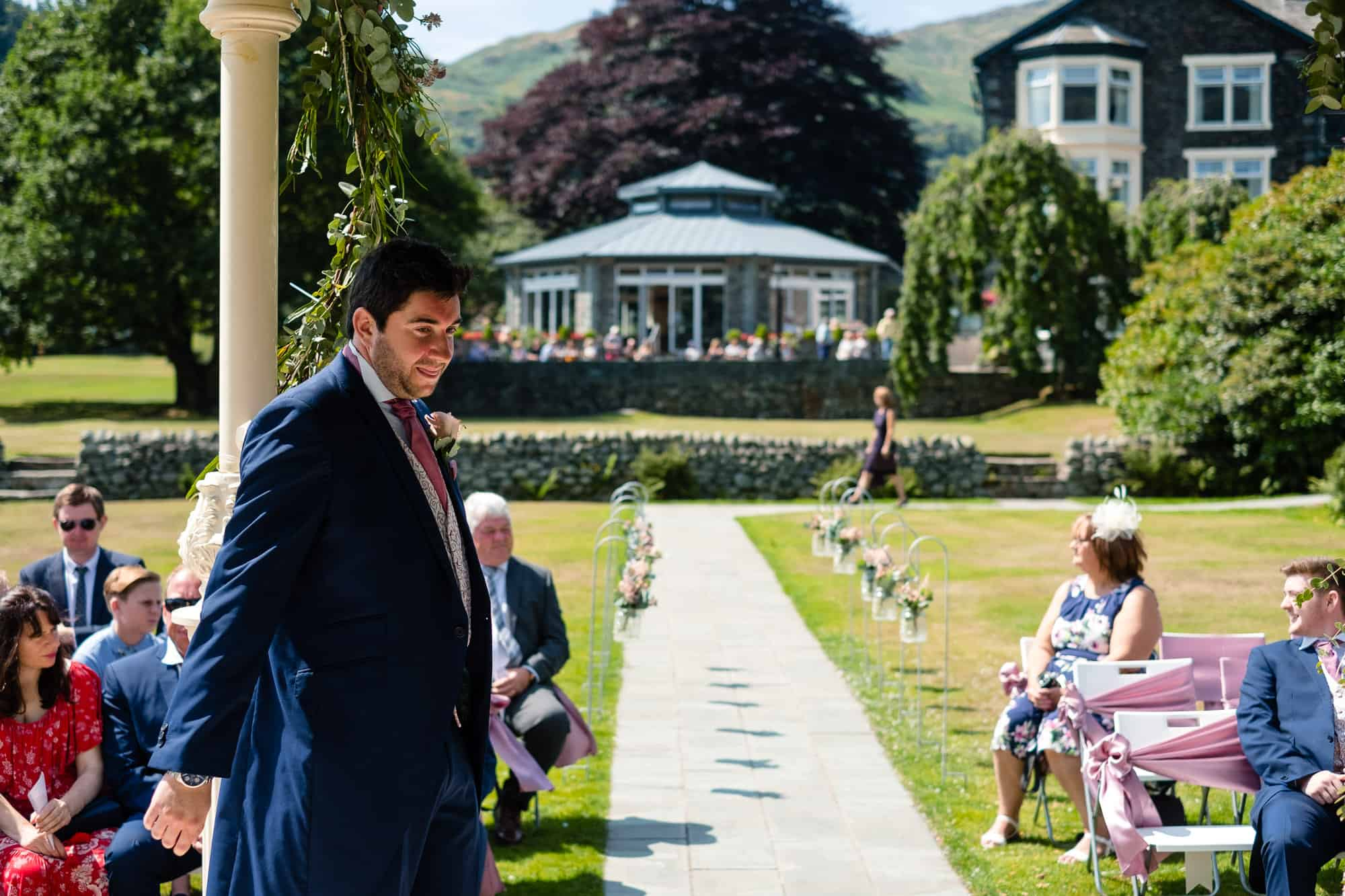 groom waiting under the gazebo for his bride to arrive