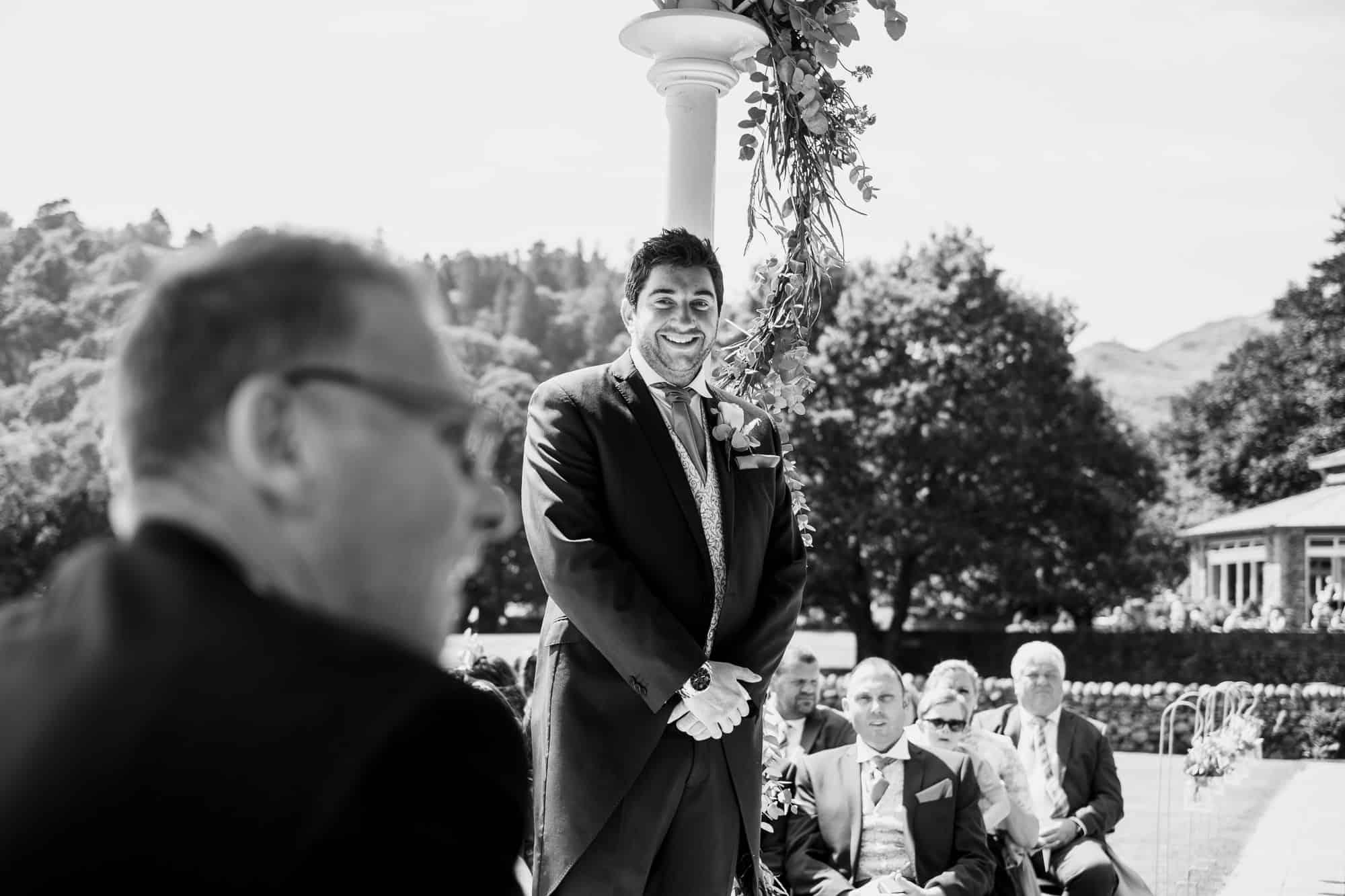 groom smiling as he waits