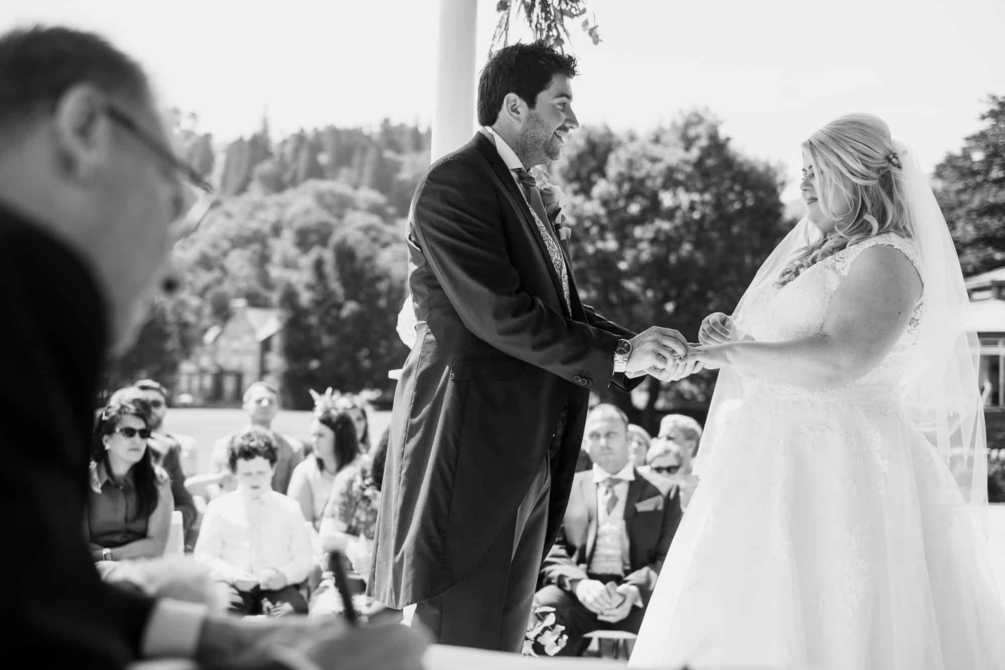 couple exchanging vows at inn on the lake