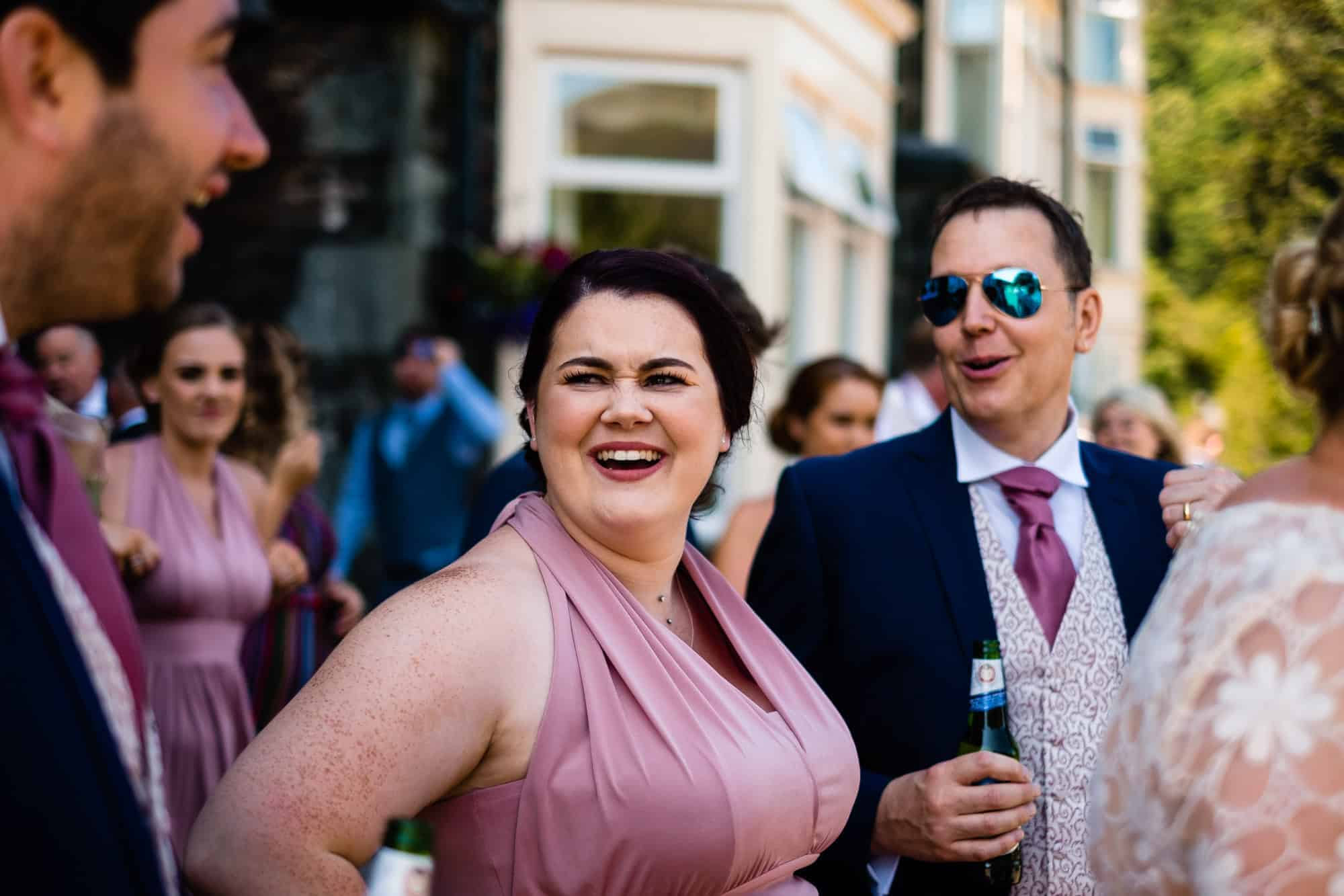 bridesmaid laughing at the groom