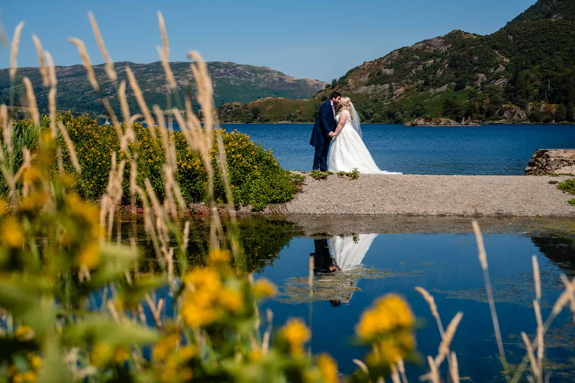 couple kissing with views of ullswater lake