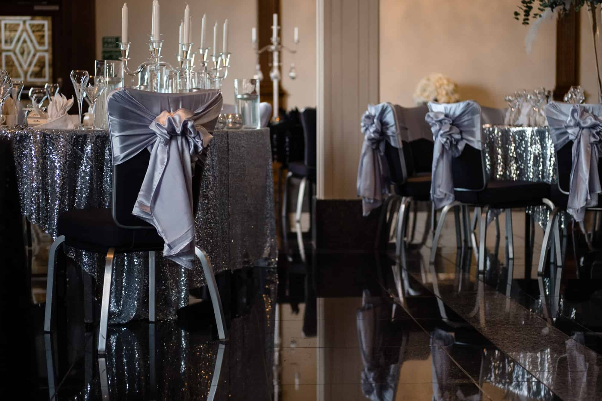 silver sequin wedding decor with grey chair covers