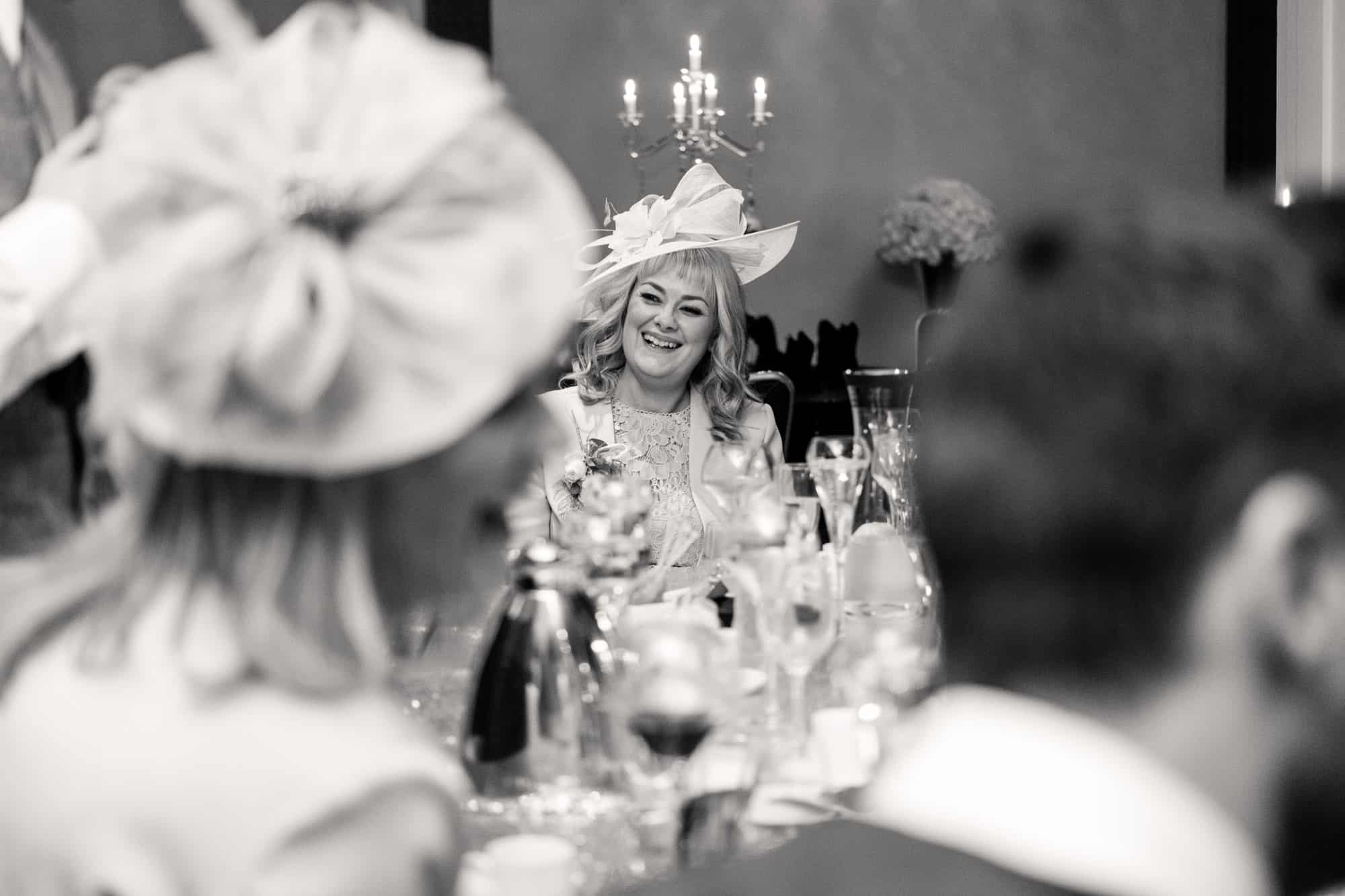 documentary wedding photograph of guest laughing