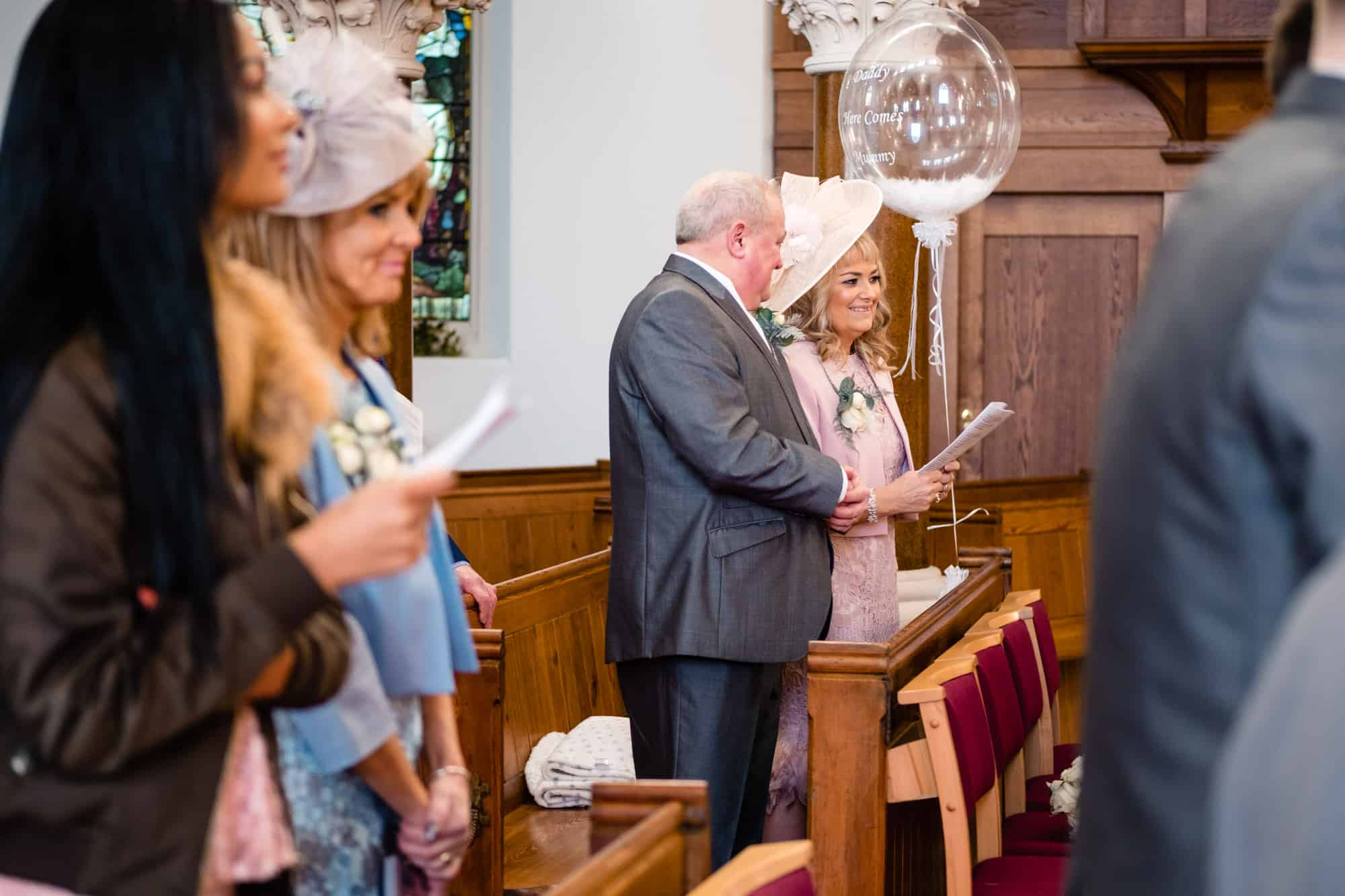 wedding guests smiling in church