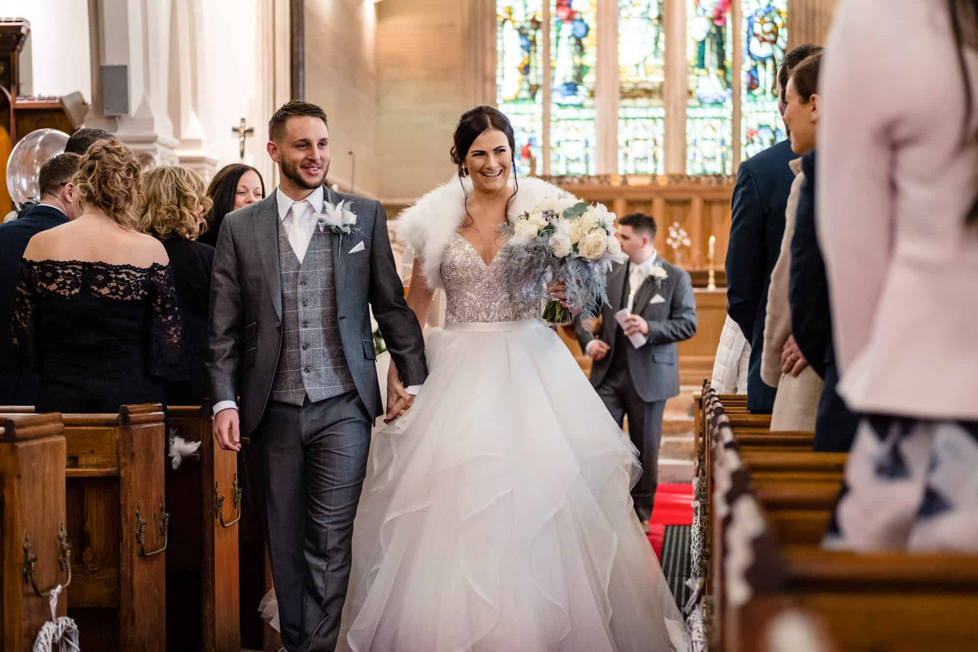 couple just married at church before the saddleworth hotel wedding reception