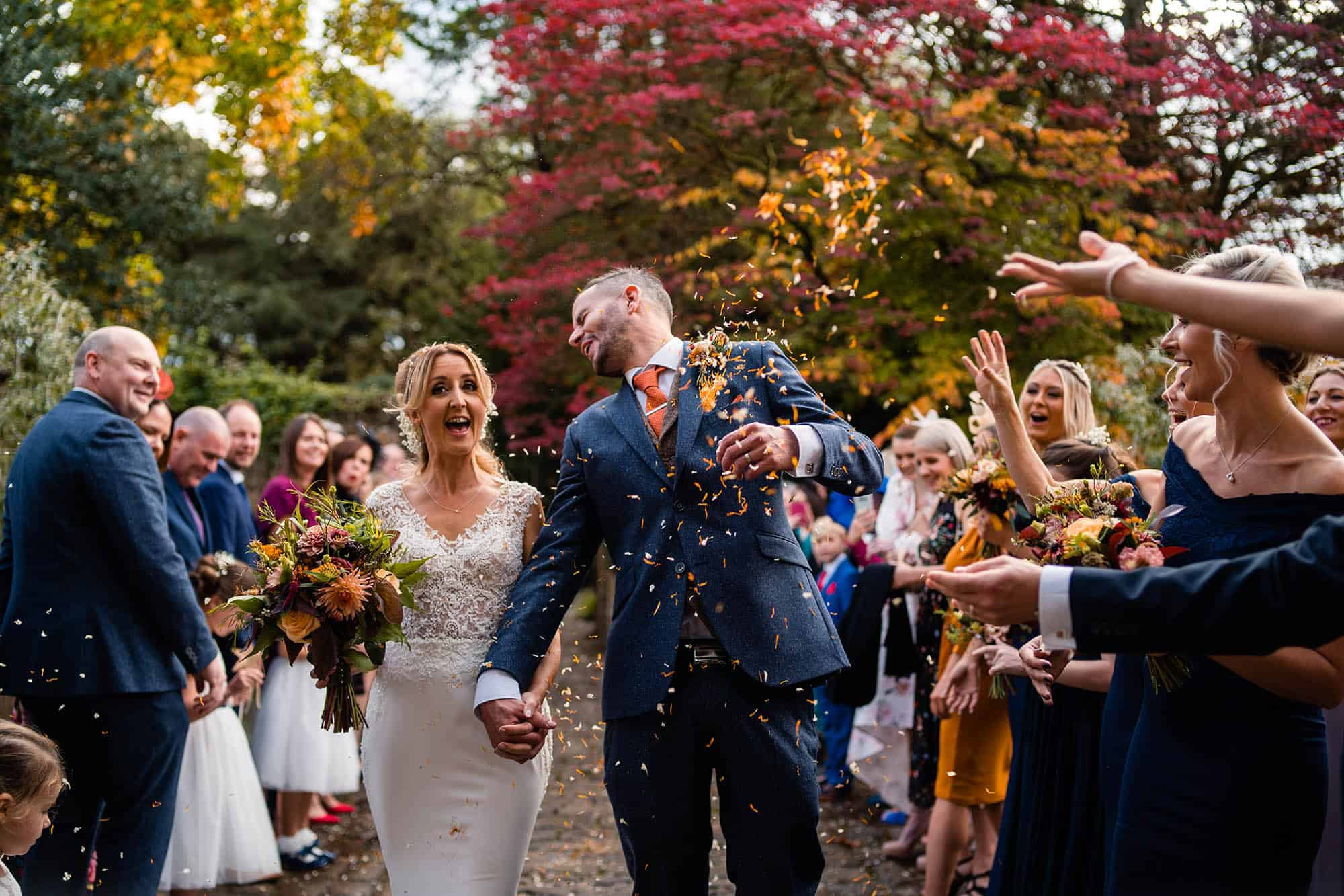 guests throwing confetti at Wyresdale Park