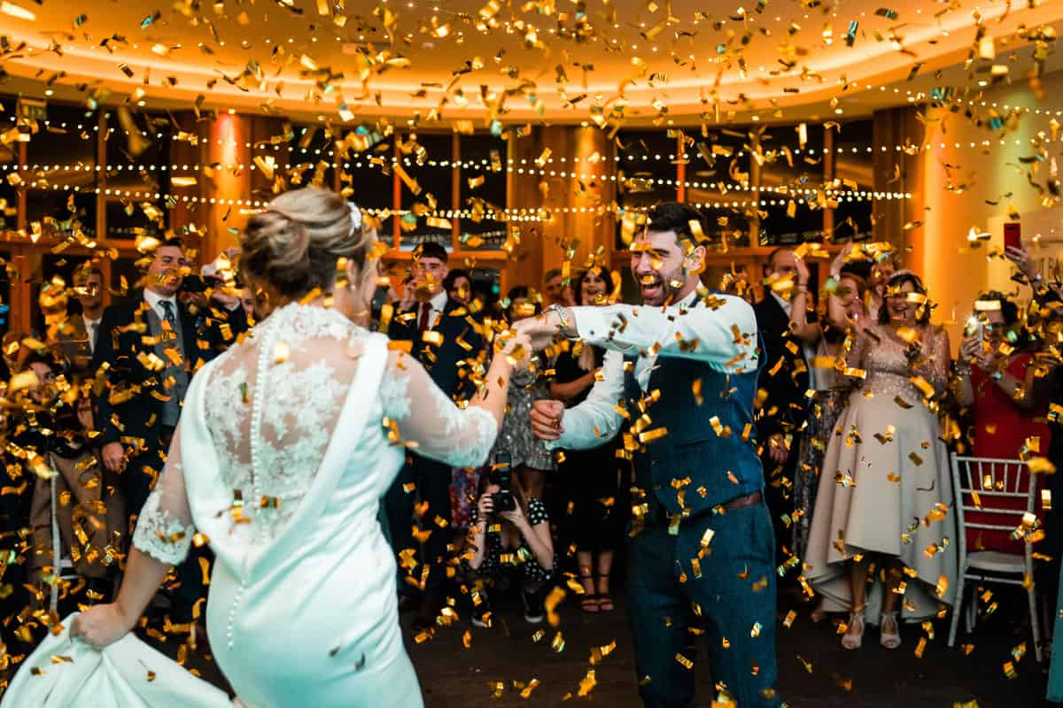 bride and grooms first dance at the outbarn with confetti cannon