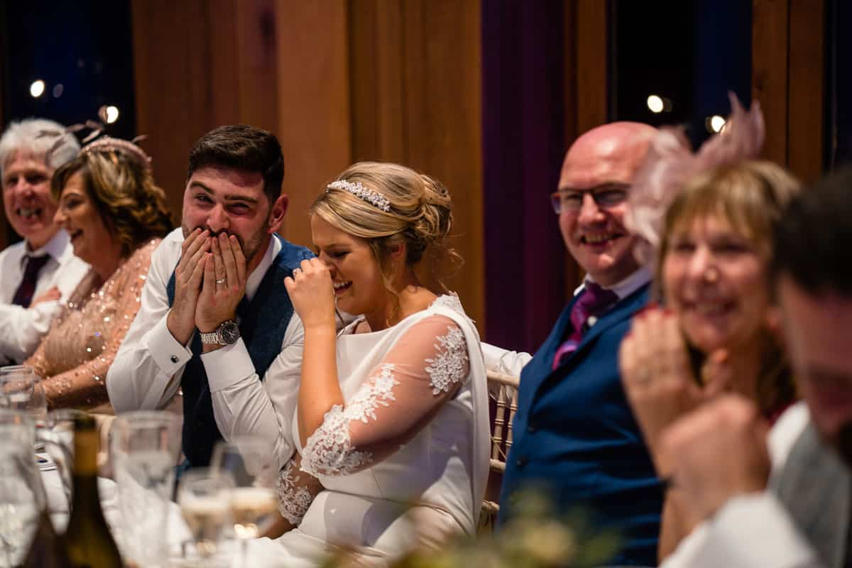 couple smiling at the funny speech