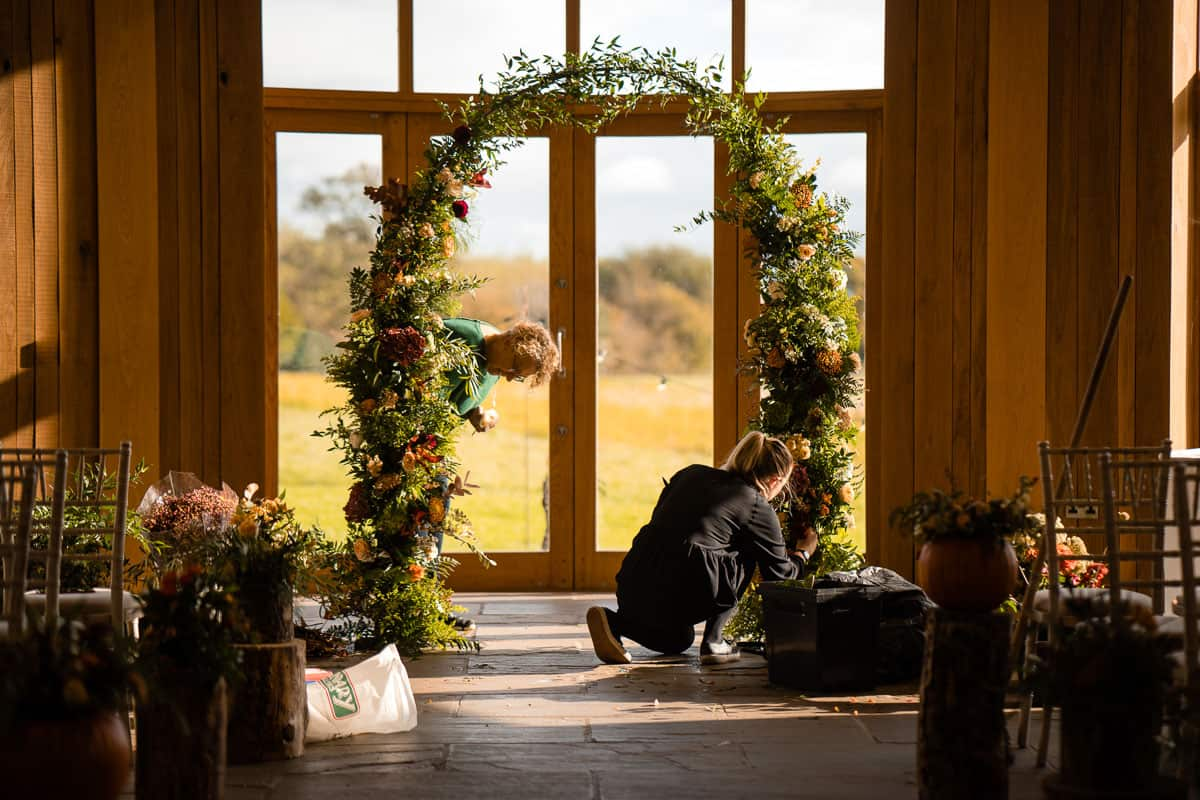 Milly Davey florist setting up arch