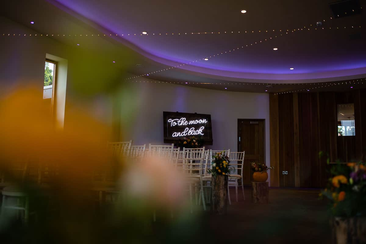 ceremony room at the outran with neon sign in background