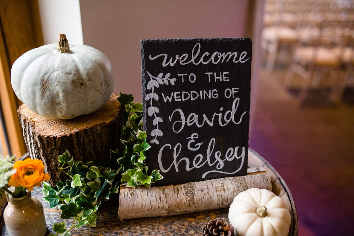 welcome sign with white pumpkins