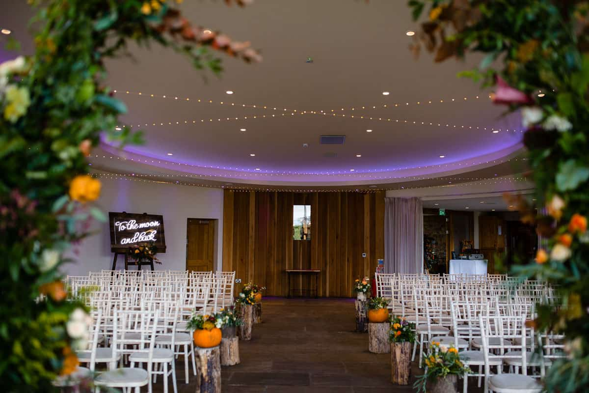 view of ceremony room with pumpkins at the outran