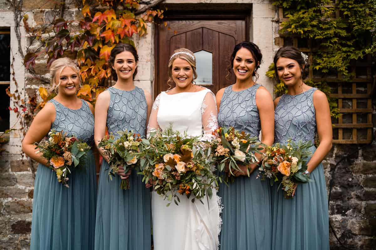 bride and bridesmaids outside the farm house