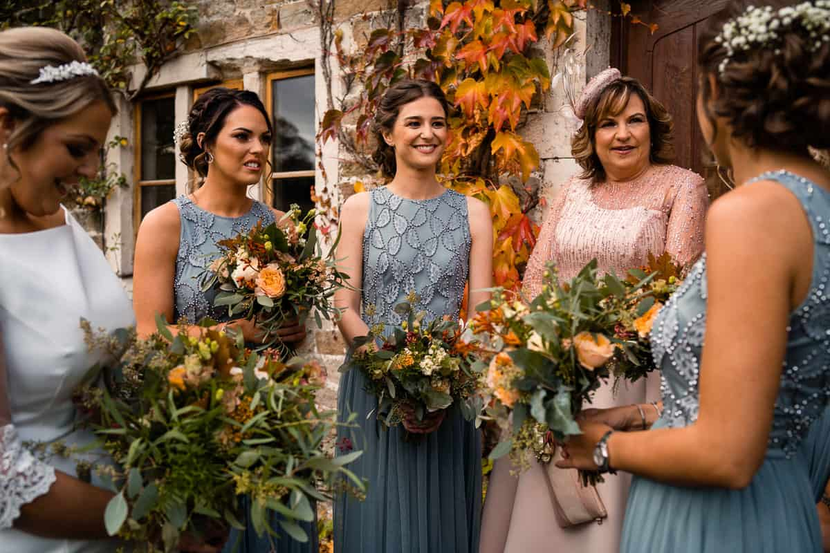 bride and her mum along with the bridesmaids