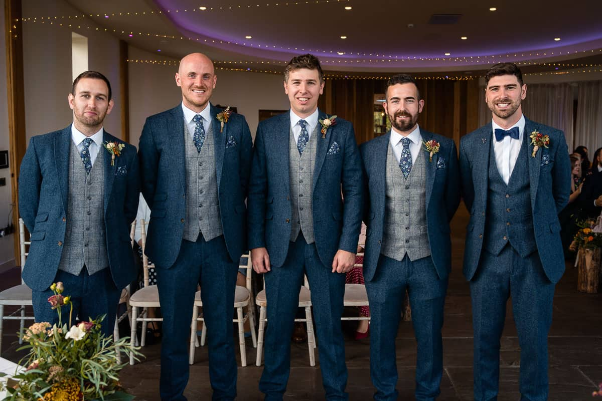groom and groomsmen together at the front of the aisle