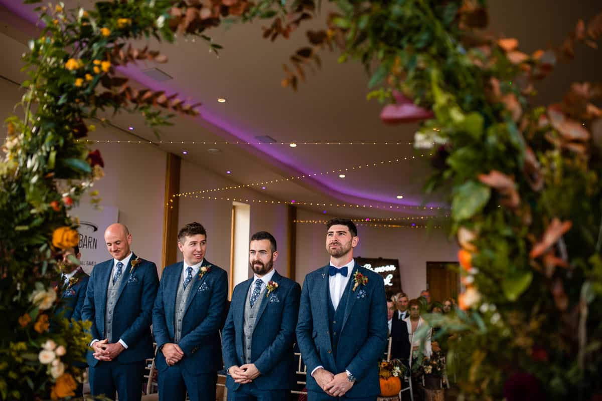 groom and groomsmen waiting nervously at the front of the ceremony room