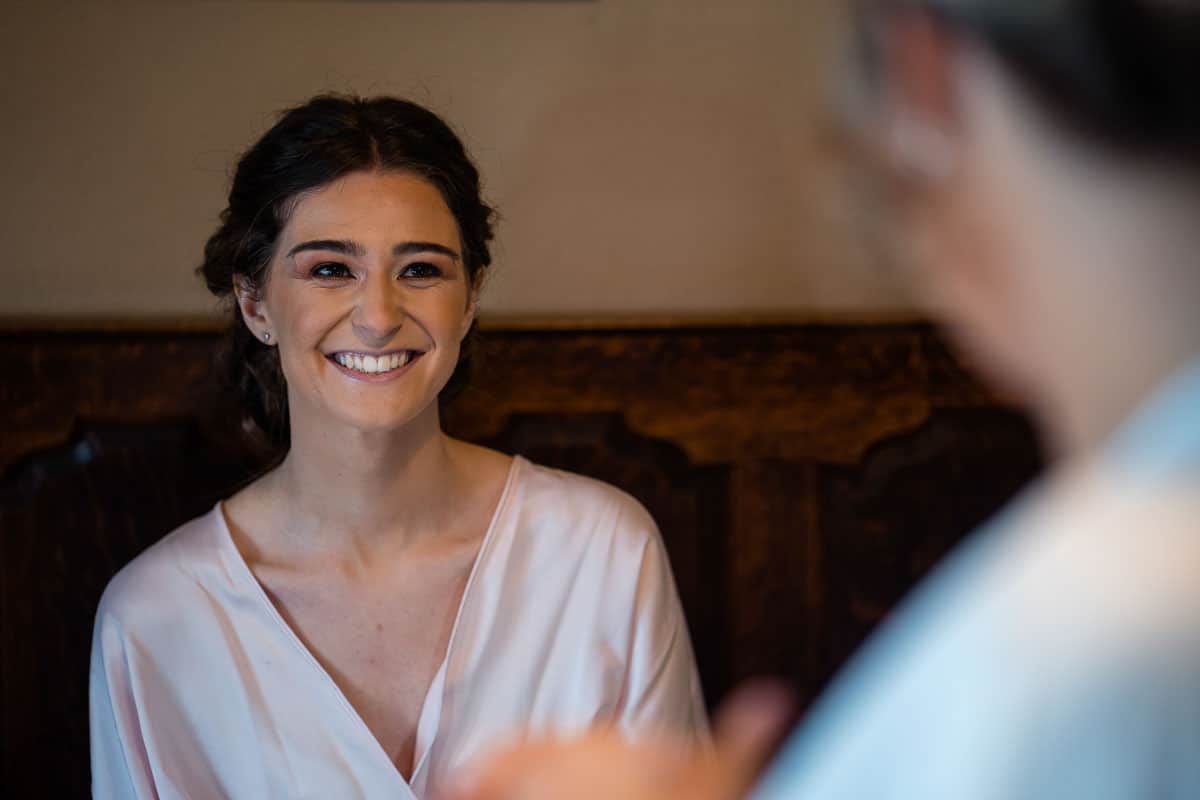 bridesmaid smiling with mother of bride