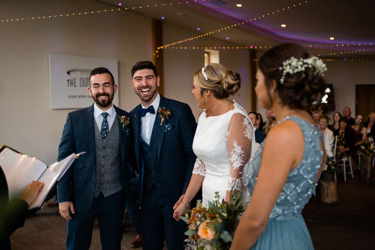 couple and witnesses smiling at each other in the wedding ceremony