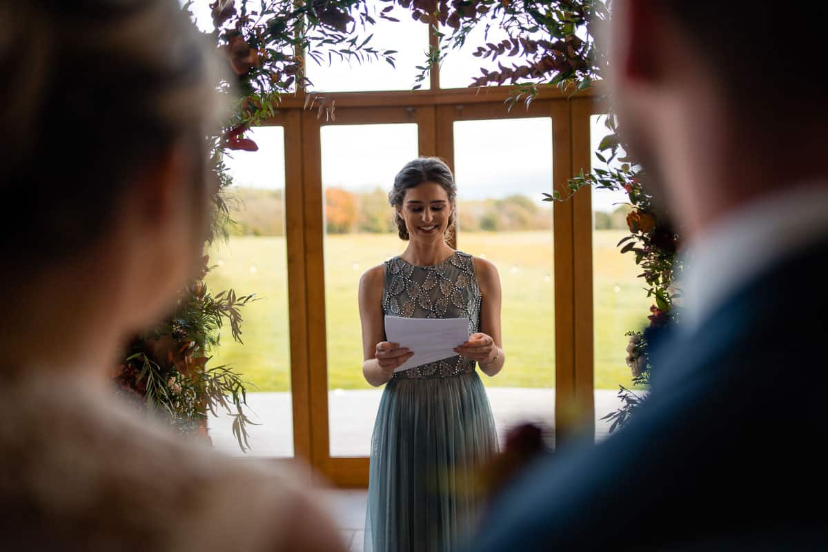 bridesmaid doing a reading in the ceremony