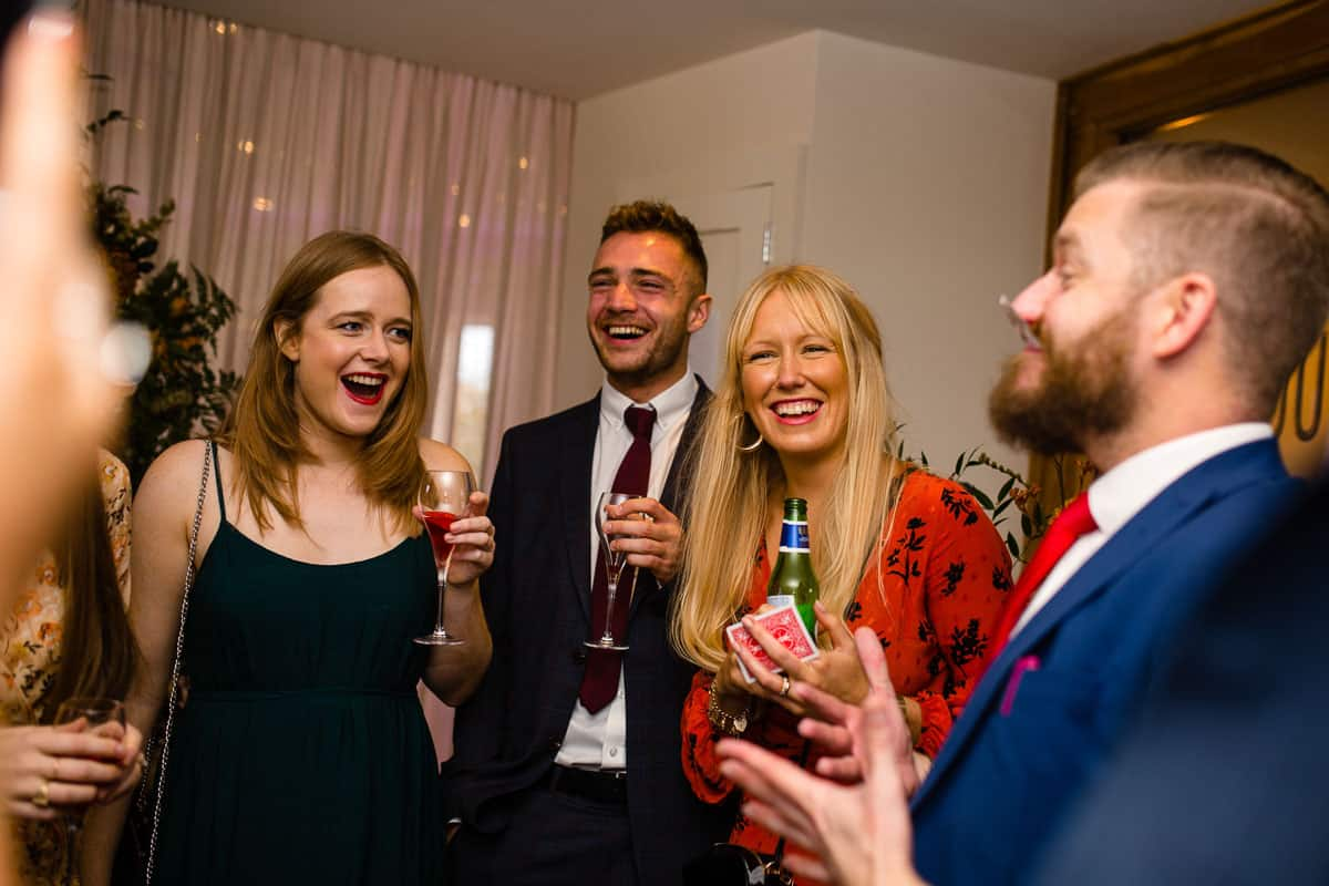 wedding guests laughing at in drinks reception