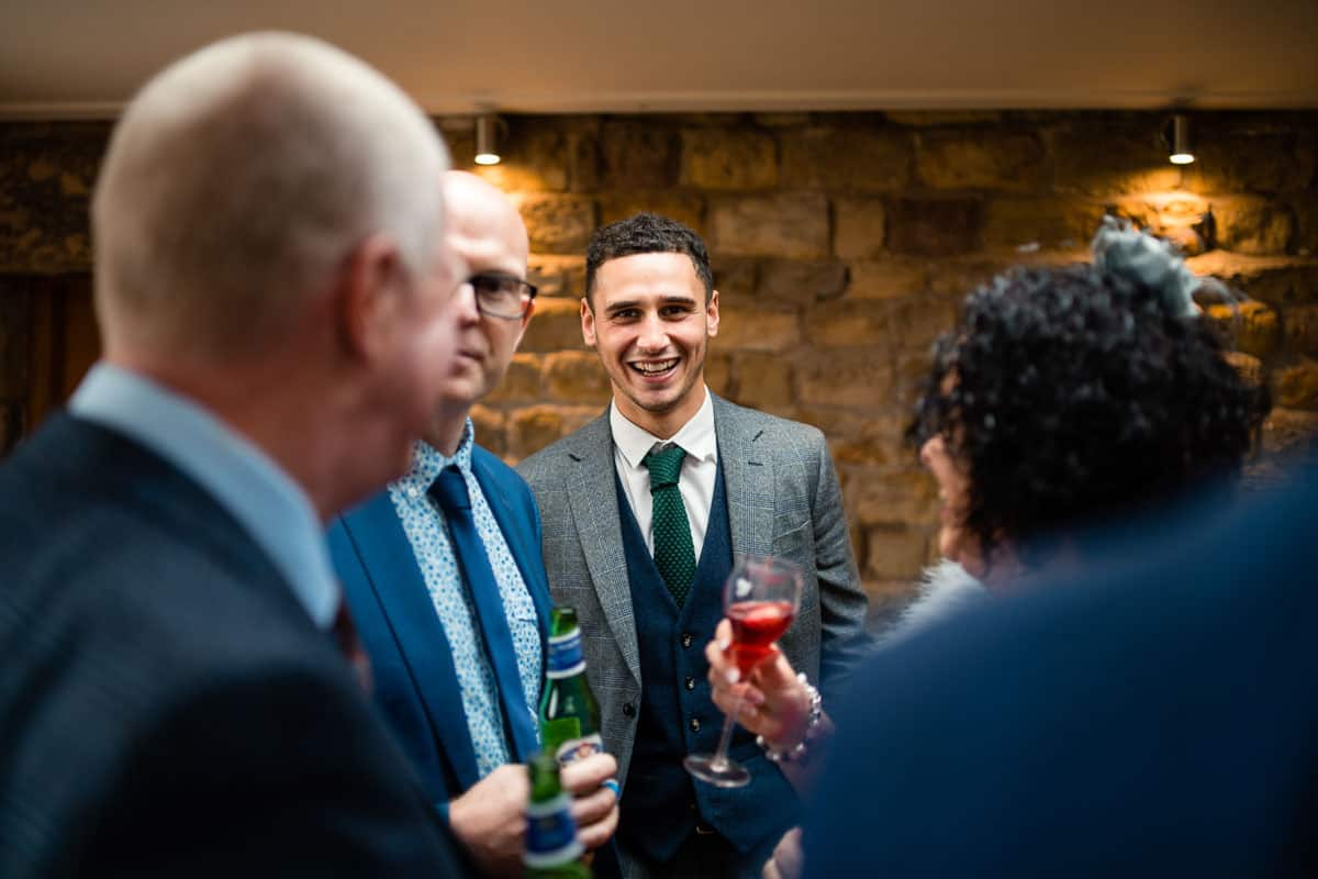 guest smiling with other wedding guests